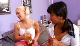 Two playful teen ladies talking on the phone looking very horny