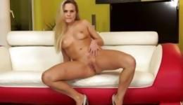 Hot blonde is getting naked and is stuffing hole with a leopard dildo