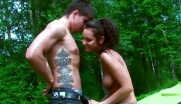 Brunette gorgeous bitch and her spouse are going to have sex outdoors