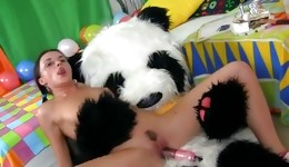 Sexy brunette hottie fucks with big panda toy like crazy