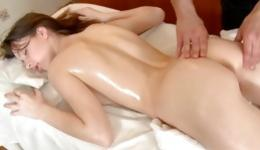 Brunette fabulous young woman is getting her skinny body massaged