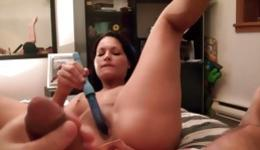 Hot brunette is stimulating her pussy hole while dude is masturbating