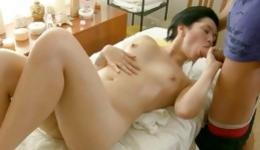 Naked brunette is massaging a long dick and gets pussy hole fingered