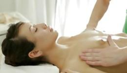 Horny asian beauty lying on massage bed getting small boobs massaged